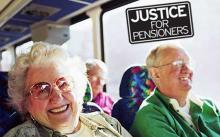Pensioners with 'Justice for Pensioners' campaign logo