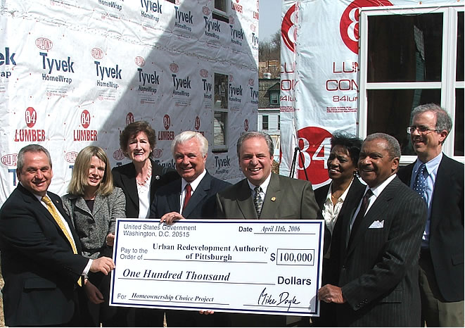 Congressman Doyle presents check for new housing construction in Garfield to Mayor O'Connor and community activists