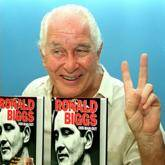 "This 21 January 1994 file photo shows British fugitive Ronnie Biggs, one of the masterminds of the Great Train Robbery in 1963, flashing the victory sign while presenting his autobiography ""Odd Man Out"" to the press in Rio de Janeiro."