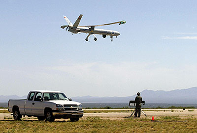Border Patrol agent uses a remote control to steer an unmanned aerial vehicle.