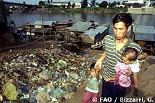 Man with his children in Phnom Penh slum