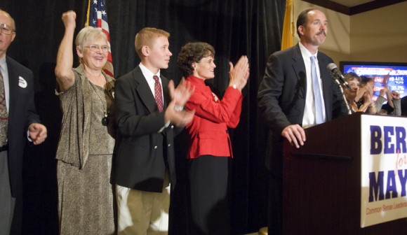 R.J. Berry accepts his victory as his parents, son and wife cheer. Photo by MG Bralley