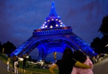 The Eiffel Tower is seen lit in the blue and yellow colours of the European Union flag to mark France's six-month presidency of the European Union, July 6, 2008. REUTERS/Mal Langsdon