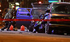 A bomb technician examines a vehicle that was packed with bomb materials in New York's Times Square