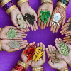 Indian children hands holding various indian cooking spices