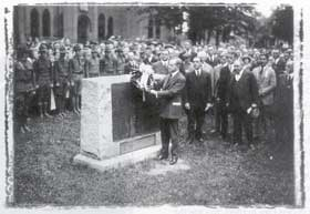 President Coolidge placing wreath on monument