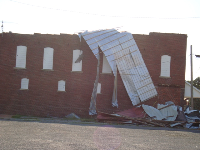 Photo of damaged building in Carrier Mills, IL