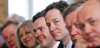 Britain?s Deputy Prime Minister Nick Clegg (C) sits with members of the coalition cabinet (L-R) David Laws, Theresa May, George Osborne, Ken Clarke and Iain Duncan-Smith during his first cabinet meeting at number 10 Downing Street in London May 13, 2010.