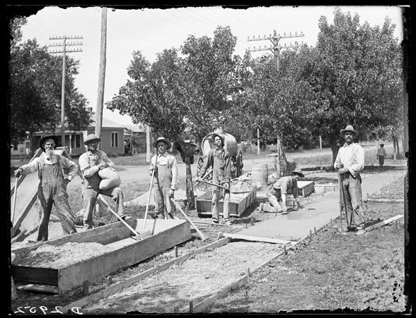 Solomon D. Butcher's photograph depicted workmen laying a concrete sidewalk. NSHS RG2608-2952