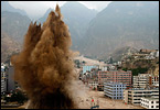 Rubble-strewn floodwaters tear through a remote corner of northwestern China.