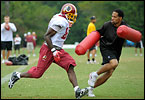 On the sixth day of training camp, Redskins coaches mix in a few new drills while Albert Haynesworth spends another day observing practice from the sidelines.