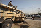 Suspected al-Qaeda militants killed five Iraqi soldiers in a brazen dawn attack Tuesday at a western Baghdad checkpoint and planted the terror group's black banner before fleeing the scene.