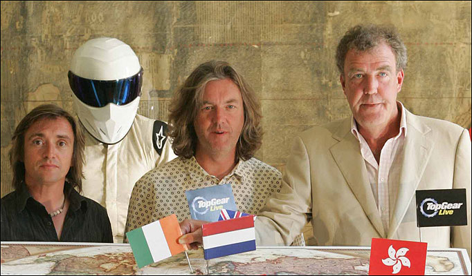 Top team ... The Stig with, from right, Jeremy Clarkson, James May and Richard Hammond