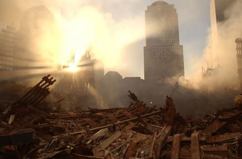 The sun streams through the dust over the wreckage of the World Trade Center. 911 Pictures: World Trade Center   9 Years Later