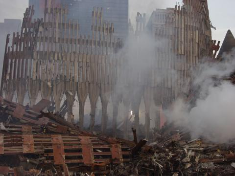 Smoke still billows from the remains of the World Trade Center. The clean up operation is expected to take months.