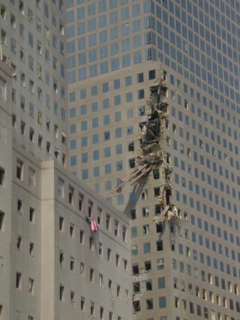 Ohio Task Force workers anchored this 600,000 pound beam from the World Trade Center lodged in a nearby building.