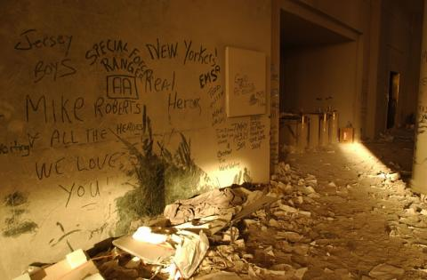 Messages written in the dust on the walls of buildings adjacent to the World Trade Center.