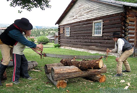Seeing and sawing as these old-timey gents slowly cut a log