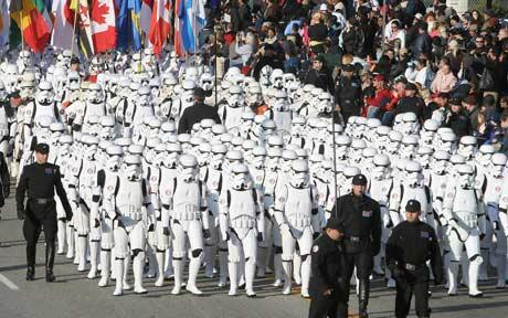 Star Wars fans dressed as storm troopers during a parade in America: Star Wars Day: 'may the fourth be with you', say fans in tribute to cult films