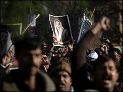 Supporters of slain opposition leader Benazir Bhutto hold photos of her as they march during a demonstration in Rawalpindi near Islamabad, Saturday, Dec. 29, 2007. Mass rioting following the assassination of opposition leader Benazir Bhutto has led to the deaths of 38 people and caused tens of millions of dollars in damage, the government said Saturday.