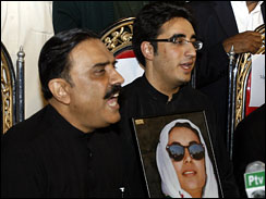 Bilawal Zardari, center, son of slain former prime minister of Pakistan Benazir Bhutto addresses a news conference with his father Asif Ali Zardari, left, and party president Amin Fahim after he has been nominated Chairman of Bhutto's People's party in Naudero near Larkana, Pakistan on Sunday, Dec. 30, 2007.