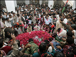 Supporters of Pakistan's former Prime Minister Benazir Bhutto visit the grave of their leader in Garhi Khuda Bakhash near Larkana, Pakistan on Dec. 30, 2007. Pakistan rejected an outside investigation into the assassination of Bhutto, despite controversy over the circumstances of her death and three days of paralyzing turmoil.