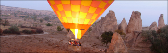 Hot air balloons are popular for those wanting to enjoy the beauty of Anatolia from the air. Photo credit - khoogheem