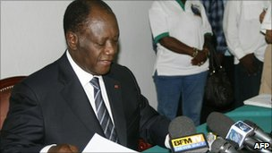 Alassane Ouattara at a press conference, 2 December 2010