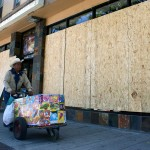 A record shop along International Blvd. was among the businesses who covered windows with plywood Thursday. (CALIFORNIA BEAT PHOTO)