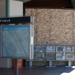 Plywood covers glass windows at Fruitvale BART station, where Oscar Grant was killed. (CALIFORNIA BEAT PHOTO)