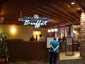 Coyote customers browse Cedar Plank Buffet menu