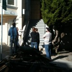 Residents and neighbors of a 16th Street apartment building gutted by flames meet in front of the building.