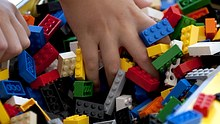A child plays with Lego blocks