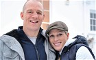 Zara Phillips, daughter of Princess Anne, and grand-daughter of Britain's Queen Elizabeth II, posing for a photograph with her fiance, England rugby player Mike Tindall, after the announcement of their engagement, at their home in Gloucestershire