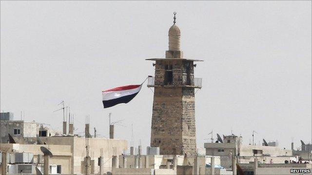 Syrian flag flying at Omari mosque