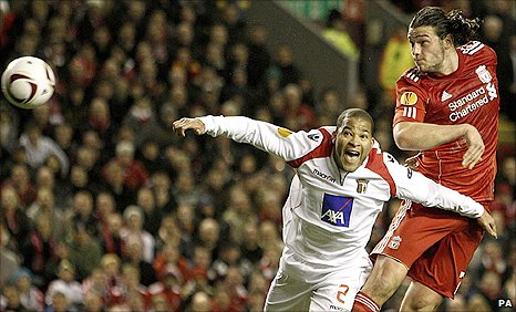 Liverpool striker Andy Carroll (right) sends a header wide against Braga