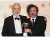 Lee was presented the Academy Fellowship by filmmaker Tim Burton. (Pic: BAFTA/Richard Kendal)