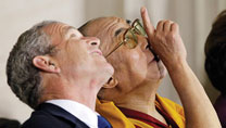 George W. Bush welcomes and honors his lookalike, Dalai Lama