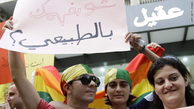 """Protesters in Beirut, Lebanon, on International Day Against Homophobia 2010. Their banner reads """"What do you know about being normal?"""""""