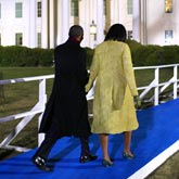 Barack and Michelle Obama walk towards the White House
