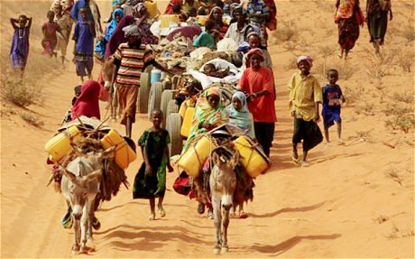 Somalians walk along the main road leading from the Somalian border to the refugee camps around Dadaab, Kenya
