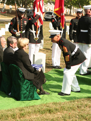 Sgt. Maj. Jimmy Mashburn, former sergeant major of Regimental Combat Team 7, pays his respects to Valerie Bale, niece of Pfc. Carl A. West, during West's interment with full military honors at Arlington National Cemetery, Oct. 4. The Department of Defense Prisoner Of War/Missing Personnel Office announced recently that the Marine?s remains had finally been found and identified after being labeled as Missing in Action for more than 57 years. Photo by: Gunnery Sgt. Will Price