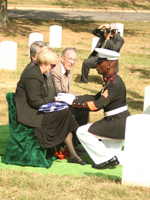 Gunnery Sgt. William Dixon, Marine Barracks Washington funeral director, pays his respects to Valerie Bale, niece of Pfc. Carl A. West, during West's interment with full military honors at Arlington National Cemetery, Oct. 4.  The Department of Defense Prisoner Of War/Missing Personnel Office announced recently that the Marine?s remains had finally been found and identified after being labeled as Missing in Action for more than 57 years.   Photo by: Gunnery Sgt. Will Price