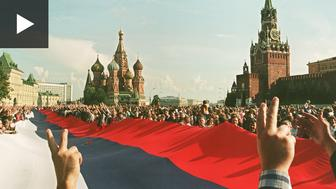 A large Russian Federation flag is unfurled in Moscow in 1991