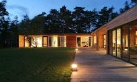 Contemporary Single Storey Home Design with Wooden Exterior and Pine Trees Around