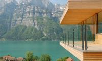 Contemporary Wooden House Design with Glass Wall and Beautiful Lake View