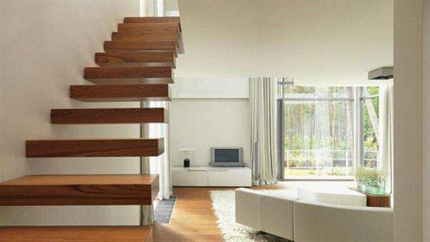 Interior Stair at Modern U-Shaped Villa Design with White Painted Exterior