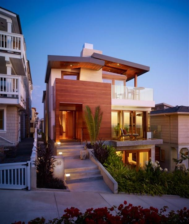 Front view of Contemporary Natural Tropical House Design features Garden