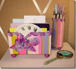 pink and purple striped desk organizer with papers, pens and mirror