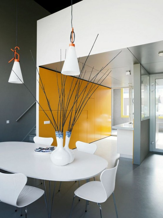 Table interior at Contemporary Patio House with Bright Yellow Exterior Looking